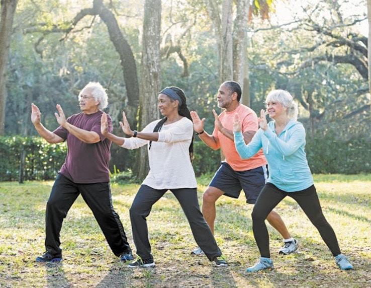 Older group exercising outside
